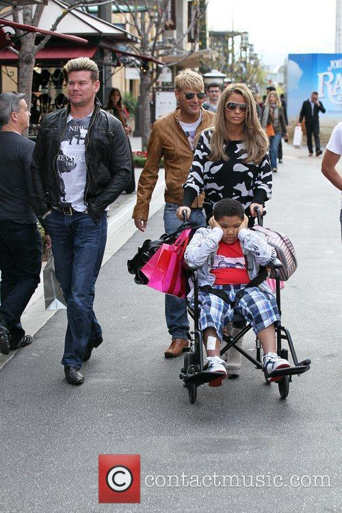 Katie Price, her son Harvey and friends Gary...
