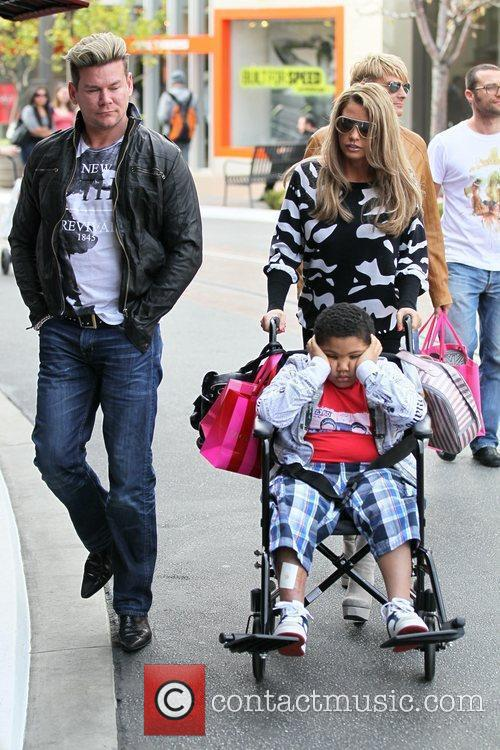 Katie Price, her son Harvey and friend Phil...