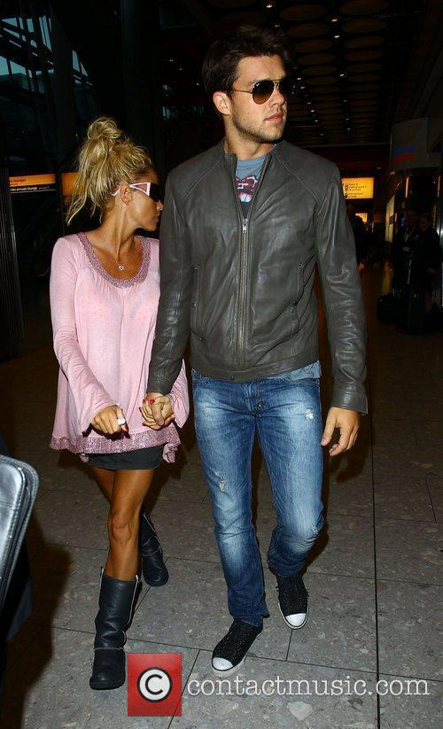 Katie Price and her boyfriend Leandro Penna arrive...