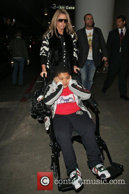 Katie Price and her son Harvey arrive at...