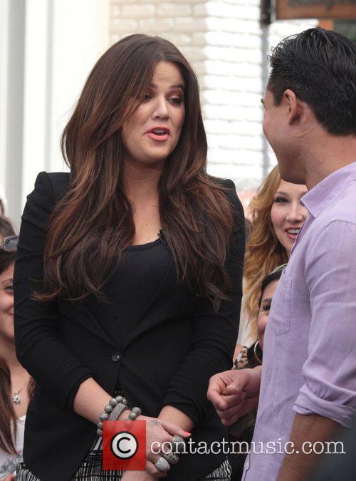 Khloe Kardashian being interviewed by Mario Lopez on...