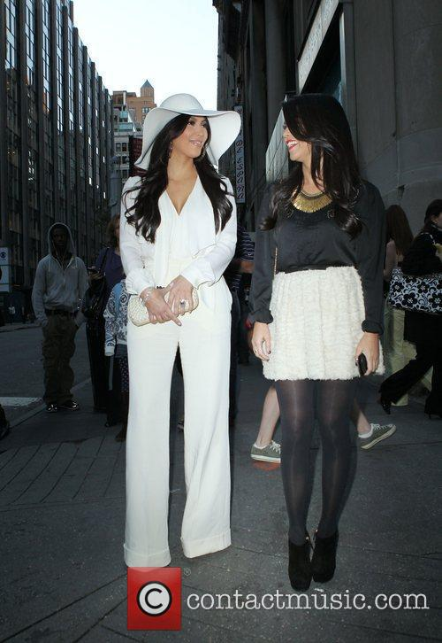 Kim Kardashian and Kourtney Kardashian 11