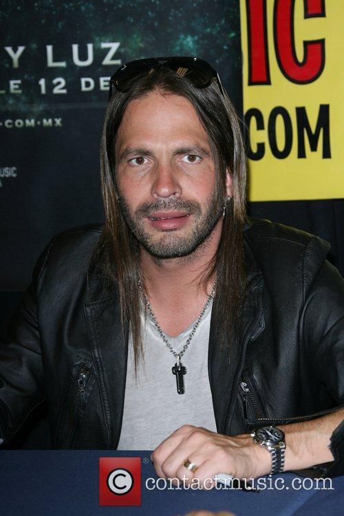 Sergio Vallin Band members from Mana' sign copies...