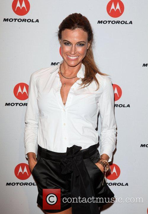 Kelly Bensimon  the DROID RAZR by Motorola...