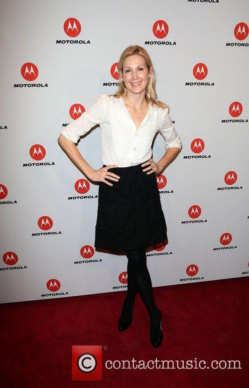 Kelly Rutherford  the DROID RAZR by Motorola...