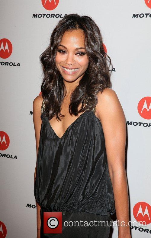 Zoe Saldana  the DROID RAZR by Motorola...