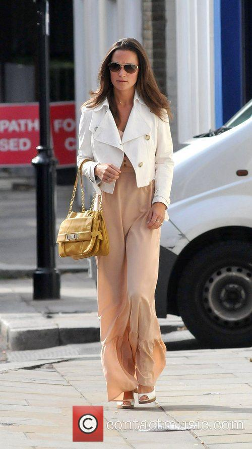 Pippa Middleton makes her way to a local...