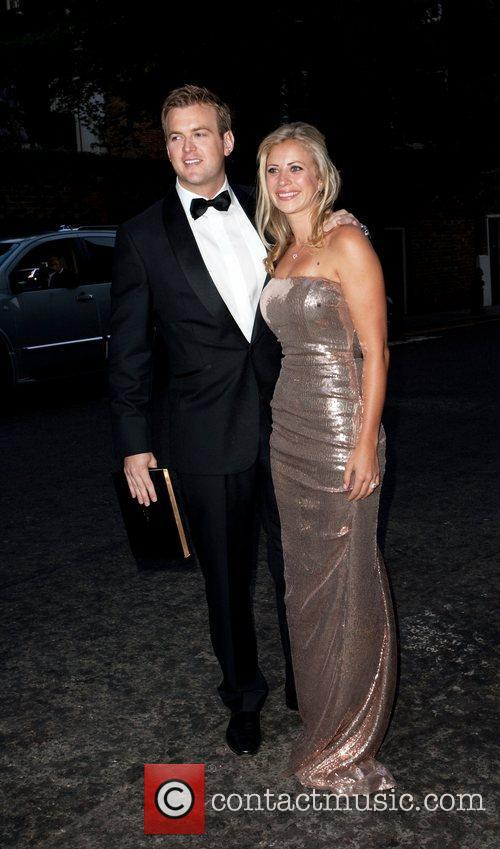 Freddie Andrews and Holly Branson arriving at a...