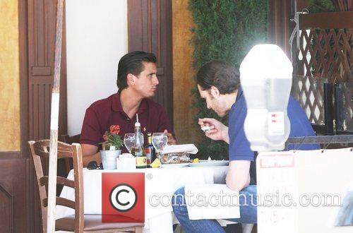Scott Disick having lunch with a friend at...