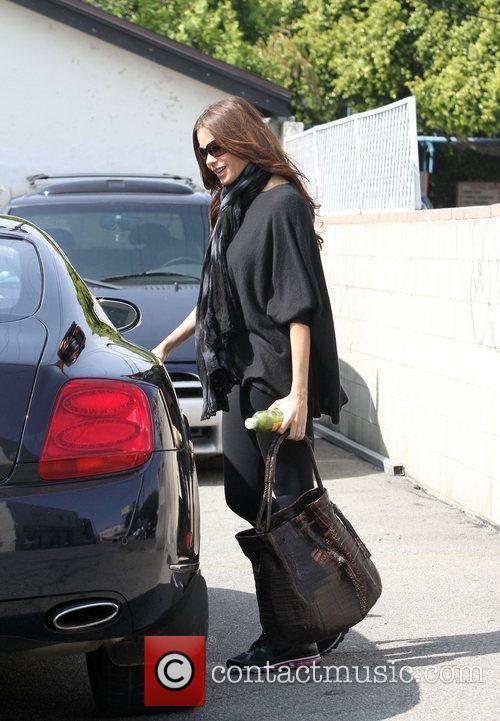 Sophia Vergara steps into a friends car after...