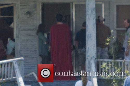 Henry Cavill dressed as Superman filming on the...