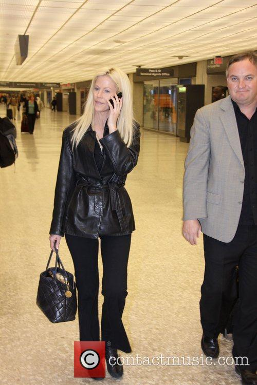 Arrive at Washington Dulles Airport after filming their...