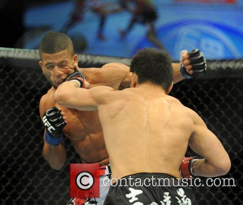 Pictured landing a punch is Michihiro Omigawa of...