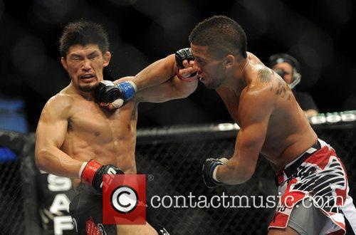 Pictured left, taking a punch is Michihiro Omigawa...