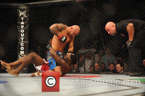 Thiago Alves in the blue shorts won his...