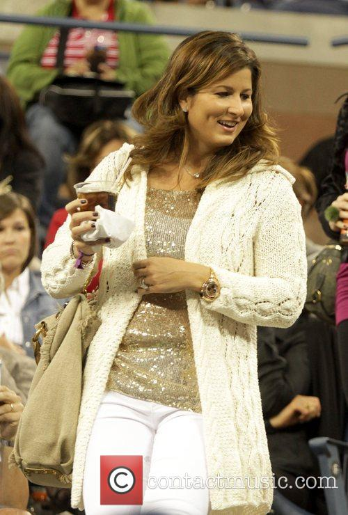 Arrives to watch the match between her husband...