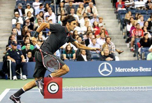 Roger Federer of Switzerland runs for the ball...
