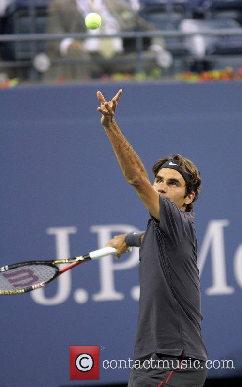 Roger Federer of Switzerland makes a serve during...