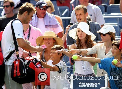 Mardy Fish of the USA signs autographs before...