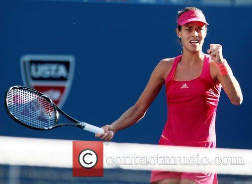 Anna Ivanovic, of SEB, celebrate after defeating Ksenia...