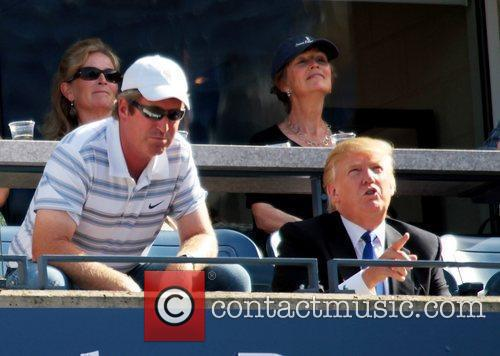 Watches the match between Maria Sharapova of Russia...