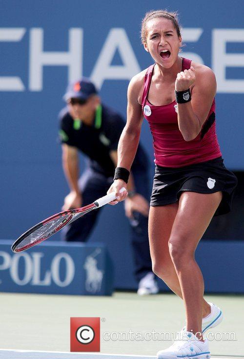 Heather Watson of Great Britain celebrates winning a...