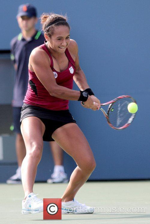 Heather Watson of Great Britain returns a serve...