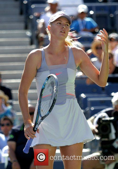 Maria Sharapova of Russia looking dejected during her...