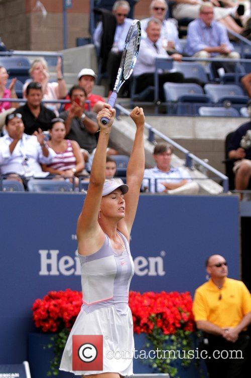 Maria Sharapova of Russia celebrates her win during...
