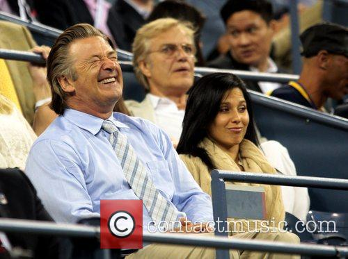 Alec Baldwin and his girlfriend watch the match...