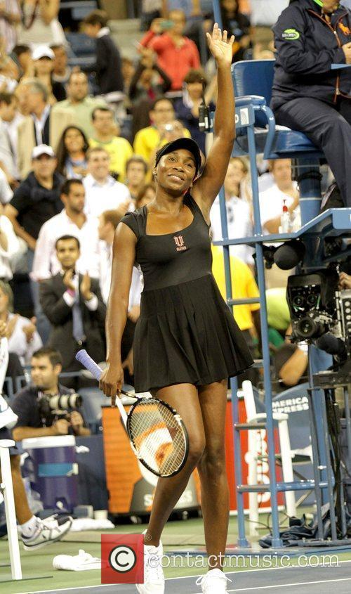 Venus Williams waves to the crowd during her...