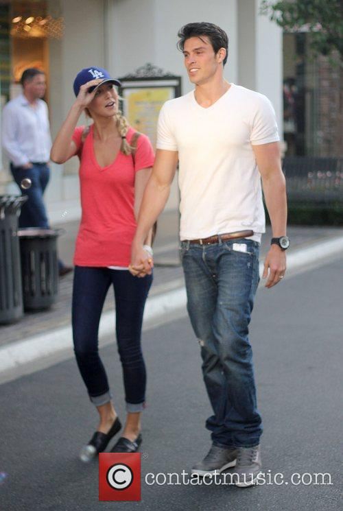 Shops with his girlfriend at The Grove in...