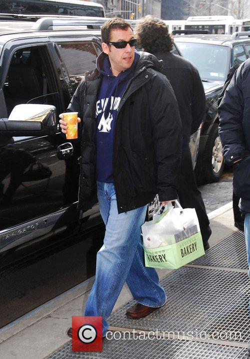 Adam Sandler leaves his midtown hotel in New...