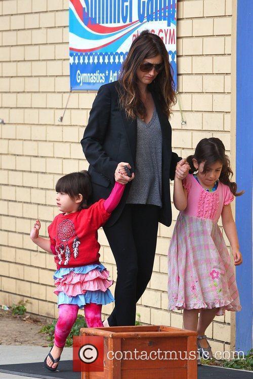 A pregnant Jackie Sandler with her daughters Sadie...