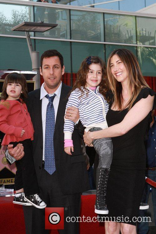 Adam Sandler with his wife and children American...