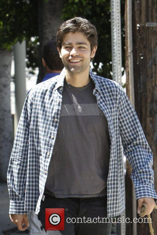 Adrian Grenier  out walking his dog in...