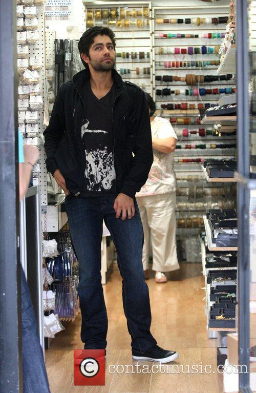 Adrian Grenier shopping at the Beads store in...