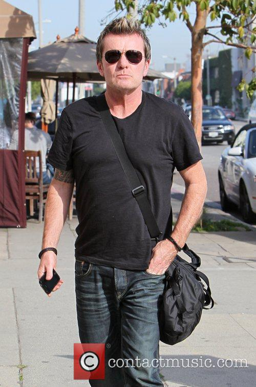 Arrives at Kings Road Cafe in West Hollywood...