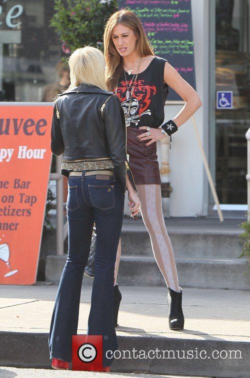 AJ Celi and a friend chatting outside Cuvee...