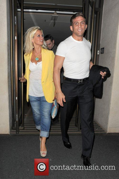 Alex Reid leaves his hotel with a female...