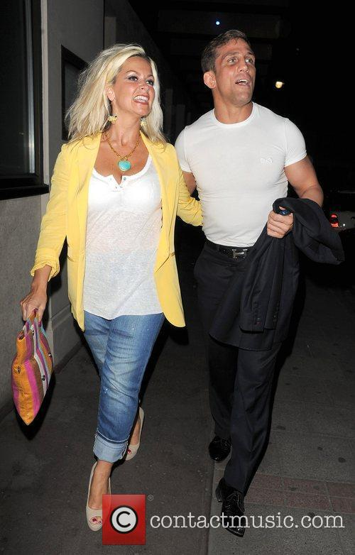 Alex Reid leaves his hotel with his arm...