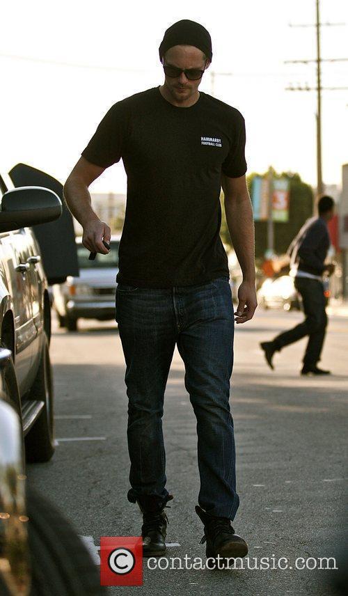 Alexander Skarsgard returns to his car after having...