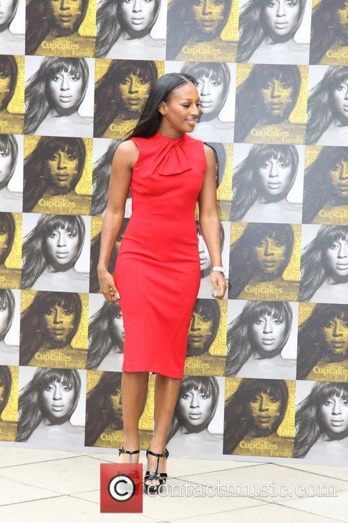 Alexandra Burke  poses for photos to officially...