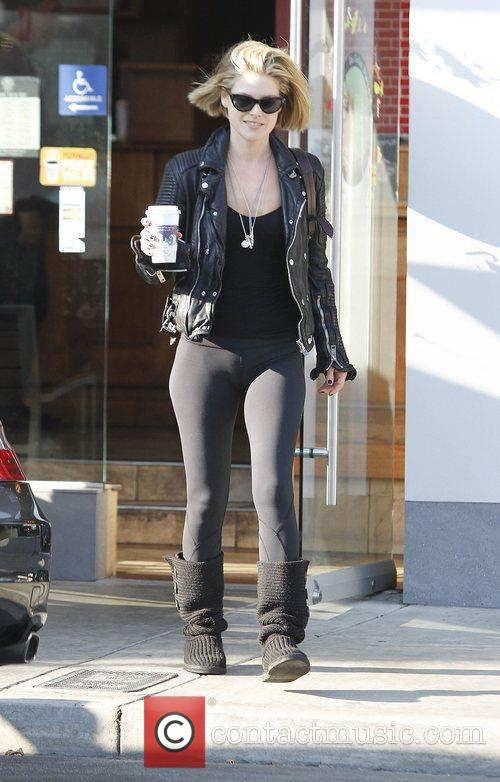 Ali Larter dressed in black gets a coffee...