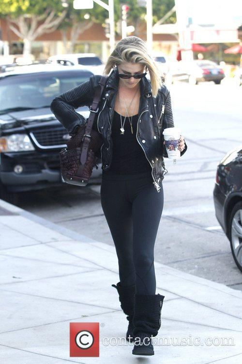 Ali Larter dressed in black gets a coffee...