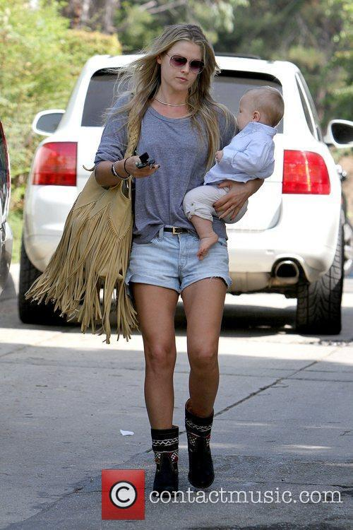 Ali Larter takes her baby son to a...