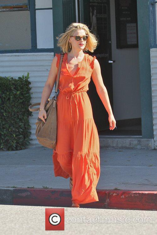 Wearing a bright orange jumpsuit while running errands...