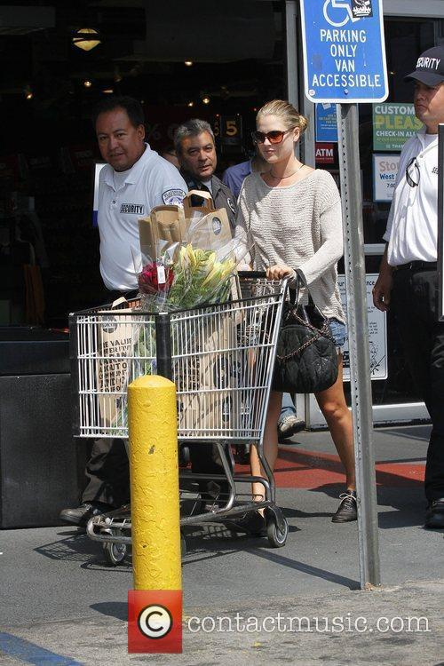 Ali Larter escorted by security after shopping at...