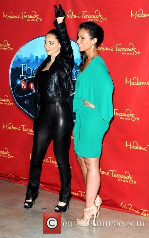 Unveils her wax figure at Madame Tussauds