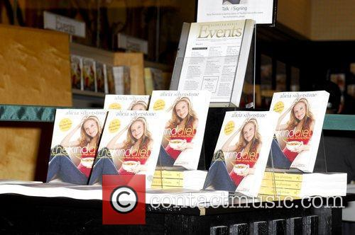 Alicia Silverstone signs copies of her new book...